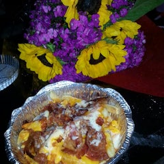Photo taken at Wrap-n-Roll Deli by Laura H. on 7/19/2014