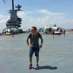 Photo taken at Beach by the USS Lexington by Burak Kaan K. on 6/27/2015