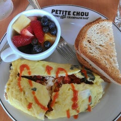 Photo taken at Petite Chou Bistro and Champagne Bar by Lynette V. on 6/24/2013