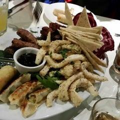 Photo taken at Giorgios Restaurant by Emile E. on 5/13/2014