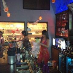 Photo taken at LIT Premium Cigar Lounge by Dennis P. on 10/28/2012