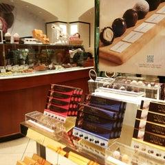 Photo taken at Godiva Chocolatier by Chaitanya Y. on 10/6/2013
