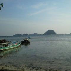 Photo taken at Pantai Pasir Putih by Nian N. on 10/11/2014