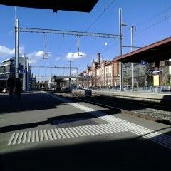 Photo taken at Bahnhof Zürich Tiefenbrunnen by Ahmet A. on 2/12/2014