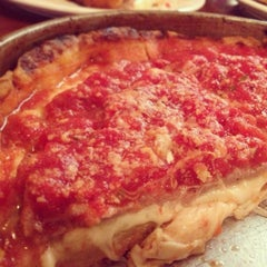 Photo taken at Lou Malnati's Pizzeria by Joy R. on 4/21/2013