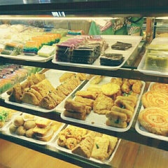 Photo taken at Mawar Bakery and Cake Shop by Roel P. on 6/27/2015