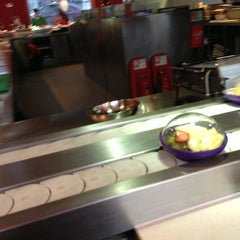 Photo taken at YO! Sushi by Jerome G. on 6/5/2013