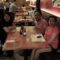 Photo taken at Max's Restaurant by Xinnea C. on 12/5/2014