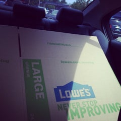 Photo taken at Lowe's Home Improvement by Gracie Z. on 7/27/2014