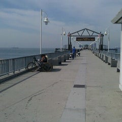 Photo taken at Belmont Veterans Memorial Pier by Molly M. on 7/10/2012