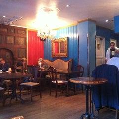 Photo taken at Tullin's Café by Sojin K. on 7/24/2012