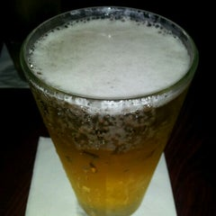 Photo taken at Quinlan's Sports Grill & Bar by Katie M. on 5/2/2012