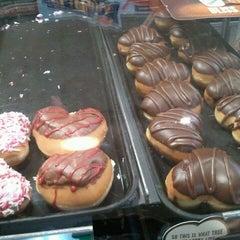 Photo taken at Krispy Kreme Doughnuts by Enrico P. on 2/12/2012