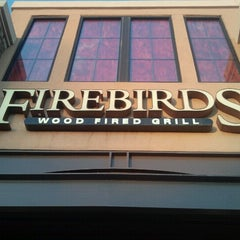 Photo taken at Firebirds Wood Fired Grill by Timothy M. on 7/7/2012