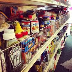 Photo taken at Clifton International Market by Sam P. on 9/2/2012