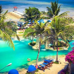 Photo taken at Grand Aston Bali Beach Resort by Amey W. on 11/28/2015