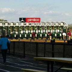 Photo taken at Pimlico Race Course by CHRIS V. on 5/2/2014