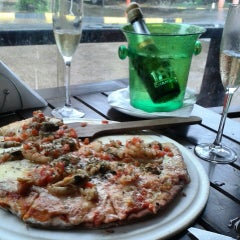 Photo taken at Bambu Resto Bar by Michele F. on 6/27/2015