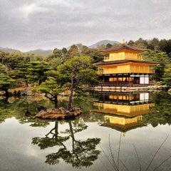 Photo taken at 北山 鹿苑寺 (金閣寺) (Kinkaku-Ji Temple) by Martin G. on 3/18/2013