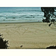 Photo taken at Nobby Beach by Mack Fitt P. on 9/13/2015