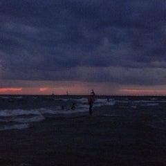 Photo taken at St. Joseph South Pier (at Silver Beach) by Ryan E. on 7/20/2013