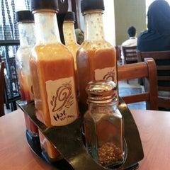 Photo taken at Nando's by Fiza E. on 11/14/2012