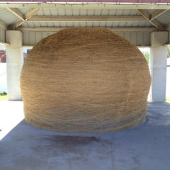 Photo taken at World's Largest Ball Of Twine   (made by a community) by Brandon on 5/21/2013