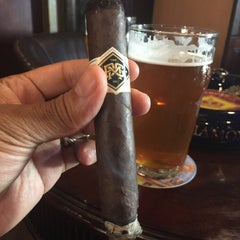 Photo taken at Churchill Cigar Lounge & Wine Bar by Michael M. on 10/10/2014