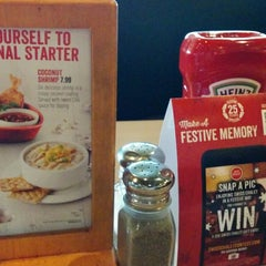 Photo taken at Swiss Chalet by Tatiana on 11/15/2014