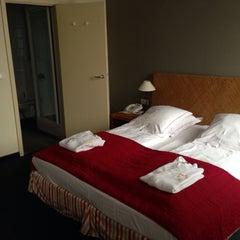 Photo taken at Ghent River Hotel by Korobov V. on 5/26/2014