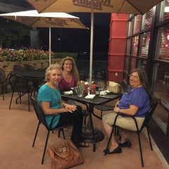 Photo taken at Red Robin Gourmet Burgers by June E. on 7/30/2015