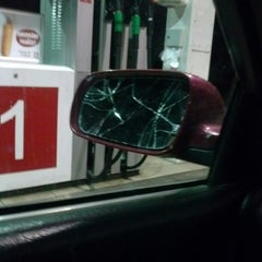 Photo taken at Lukoil by Laura R. on 9/27/2014
