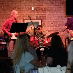 Photo taken at Mudville Grille by Brian W. on 4/12/2014