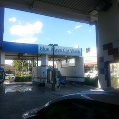 Photo taken at Blue Wave Car Wash by Manasi P. on 3/4/2014