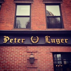 Photo taken at Peter Luger Steak House by Mike F. on 10/19/2012