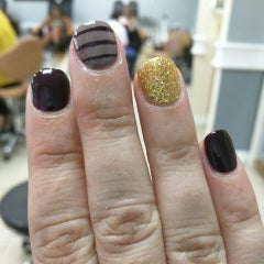 Photo taken at top hb nails by Lanette V. on 9/27/2015