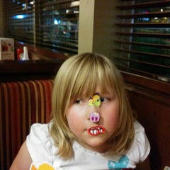 Photo taken at Swiss Chalet by Richelle L. on 10/17/2014