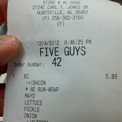 Photo taken at Five Guys by David G. on 12/5/2012