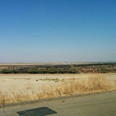 Photo taken at Harris Ranch Cattle Yards by AJ B. on 8/10/2015