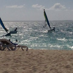 Photo taken at Club Med private beach by Dwayne W. on 9/6/2013