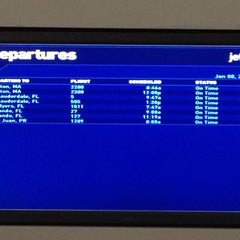 Photo taken at Gate A17 by Tere E. on 1/8/2014
