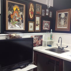 Photo taken at Living Outloud Tattoo Studio by Genna D. on 4/20/2013