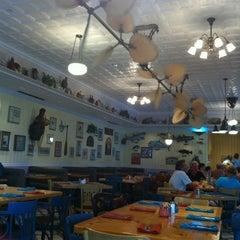 Photo taken at Olivia's Café by Izabelle D. on 6/9/2012