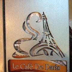 Photo taken at Le Café De París by Juan David H. on 6/17/2012