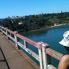 Photo taken at Ponte Internacional da Amizade by Dani V. on 3/20/2012