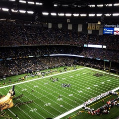 Photo taken at Mercedes-Benz Superdome by Ryan O. on 8/10/2013