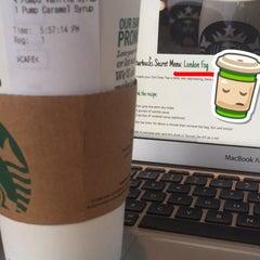 Photo taken at Starbucks by Tera D. on 5/23/2015