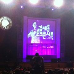 Photo taken at 연세대학교 대강당 (Yonsei University Main Auditorium) by Mia on 12/14/2012
