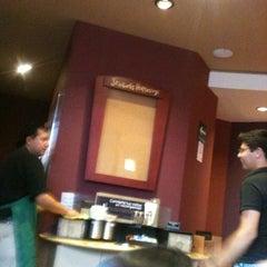 Photo taken at Starbucks by Paola B. on 10/17/2012