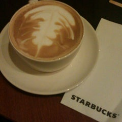 Photo taken at Starbucks by Cansu Y. on 2/15/2013